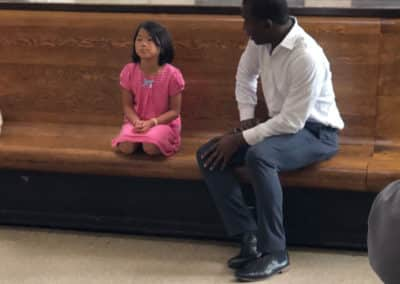 Richmond Mayer Levar Stoney talking with little girl at Red Cross blood drive
